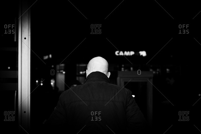 A security guard looks out a window