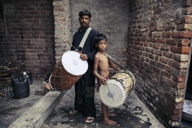 Delhi, India - June 18, 2015: Father and son musician