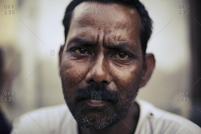 Delhi, India - June 18, 2015: Portrait of a tribesman in India