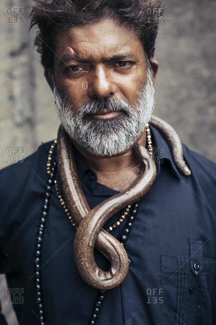 Delhi, India - June 19, 2015: Portrait of a snake charmer in India