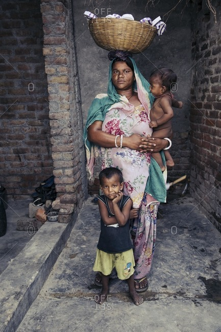 Delhi, India - June 19, 2015: Portrait of Indian woman and children