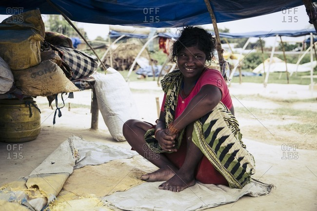 Forbesganj, Bihar, India - July 4, 2015: Tribeswoman living on roadside, India