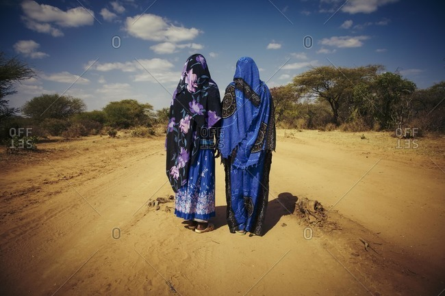 Two young women on a dirt road in Ethiopia