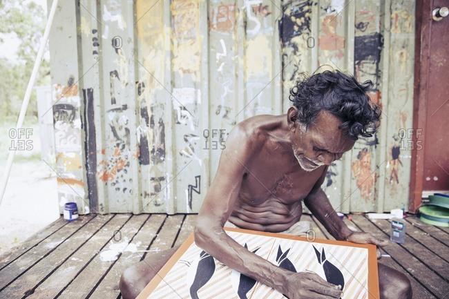Elcho Island, Norther Territory, Australia - February 21, 2011: Male artist at work,