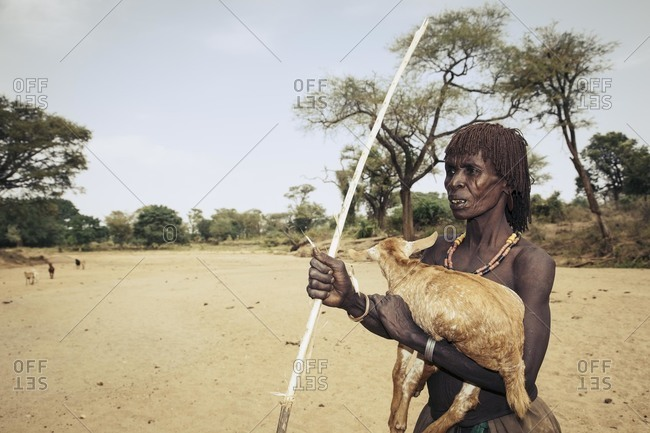 Omo Valley, Southern Ethiopia - December 7, 2010: Hamar tribeswoman holding a goat