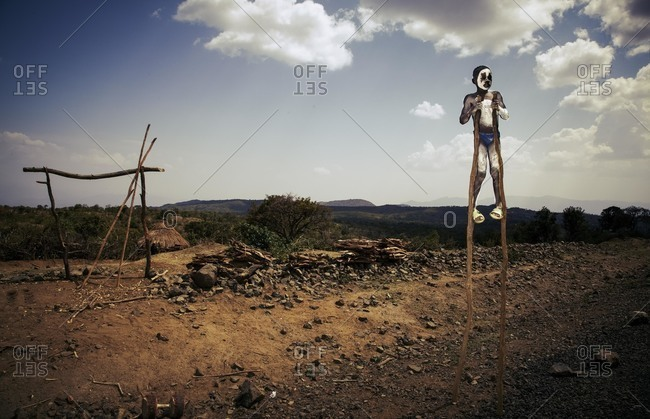 Omo Valley, Southern Ethiopia - December 7, 2010: Boy performing on stilts, Ethiopia