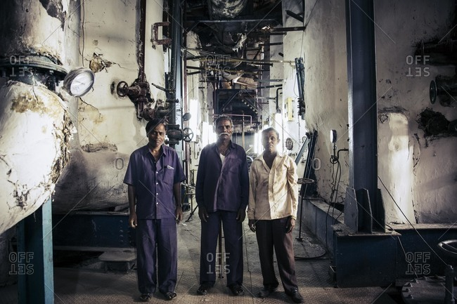 Bagalkot, Karnataka, India - November 25, 2014: Workers in a sugarcane plant, India