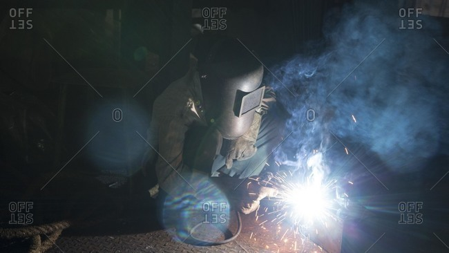 Welder in a plant, India