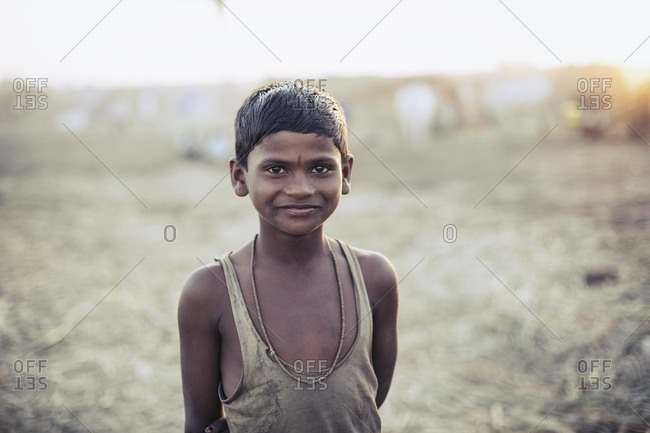 Bagalkot, Karnataka, India - December 1, 2014: A young Indian boy in rural setting