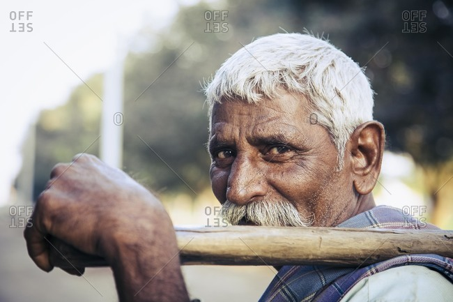 Bagalkot, Karnataka, India - December 2, 2014: Male migrant sugarcane worker, India