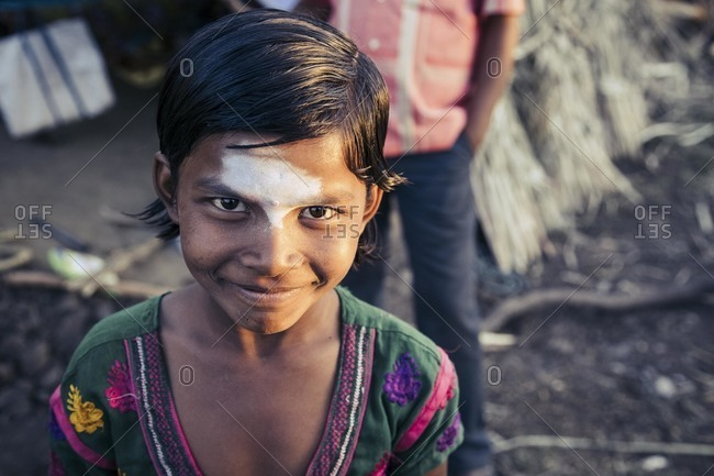 Bagalkot, Karnataka, India - December 2, 2014: Young Indian girl with paint on face