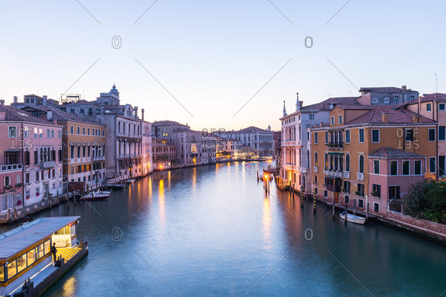 Venice, Italy - August 3, 2015: View of the Grand Canal at dusk in Venice, Italy