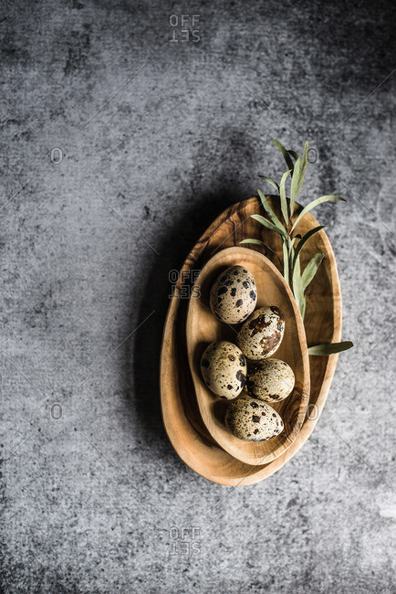 Overhead view of a bowl of quail eggs on a table