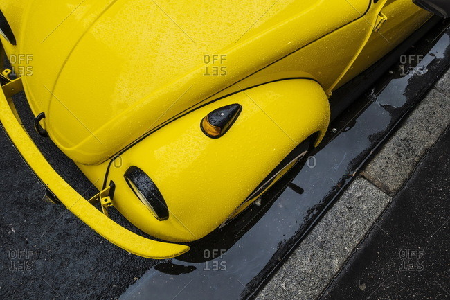 Lyon, France - December 31, 2015: High angle view of the front of a yellow classic car