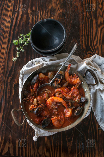 Seafood stew with shrimp, mussels, and clams served in a saute pan