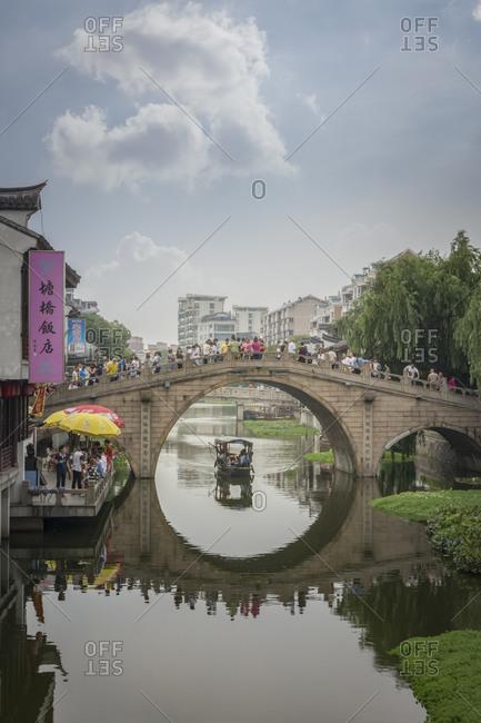 Shanghai, China - June 7, 2015: Bridge with tourists in Qibao Ancient Town, Shanghai
