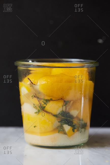Lemon preserves ingredients in a canning jar