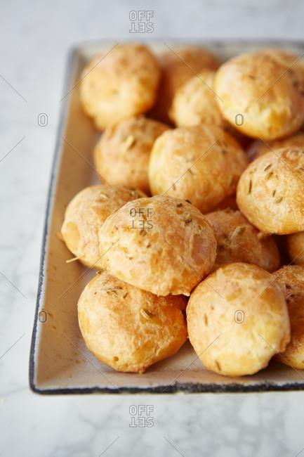 Fresh baked cheese puffs on a serving platter