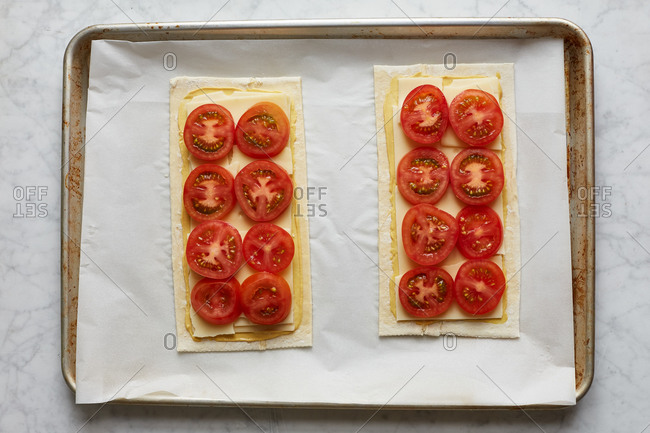 Tomato tart with cheese and mustard on a baking pan