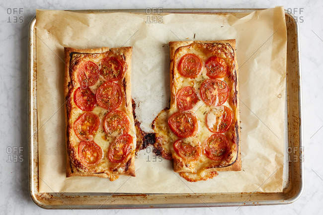 Tomato tarts on a baking sheet