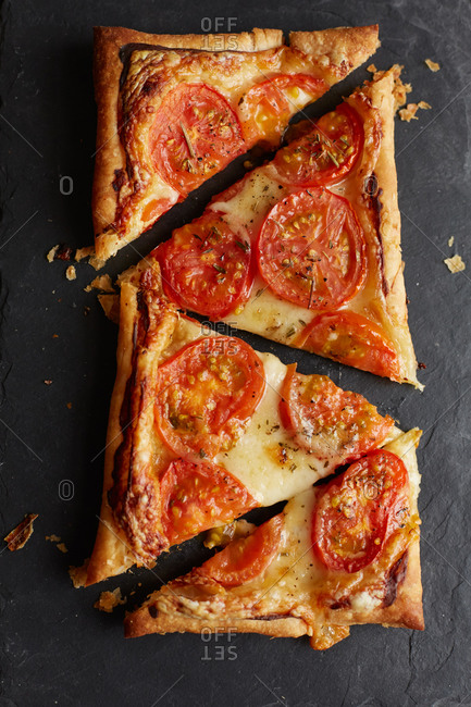 Baked tomato tart cut into triangles