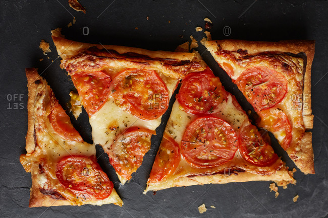 Tomato tart cut into triangular pieces