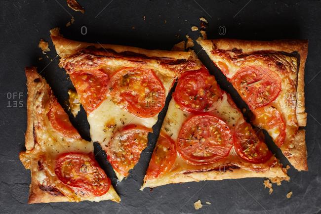 Tomato tart cut into triangular pieces