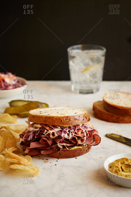 Pastrami sandwich with pickles and coleslaw