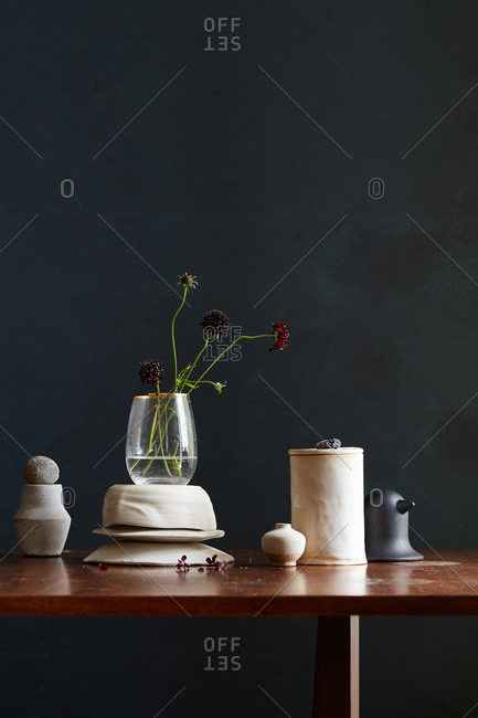 White glazed pottery and chrysanthemum blooms on a table