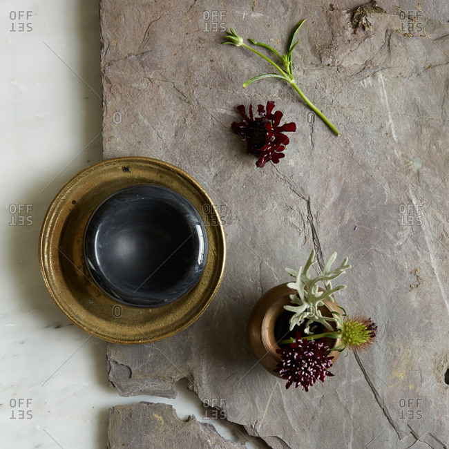 Brass bowl, flowers and slate