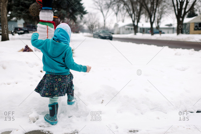 Little girl stomping through the snow