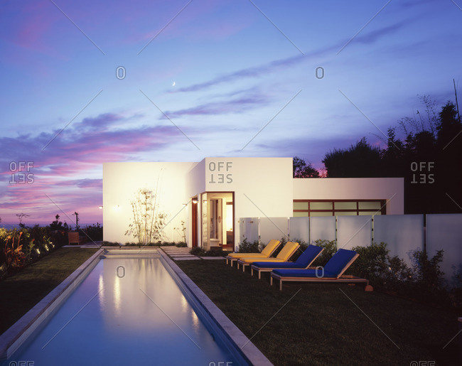 Malibu, California, USA - February 9, 2016: Swimming pool of modern home, dusk