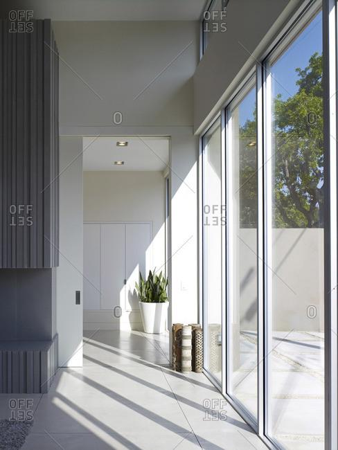 Menlo Park, California, USA - February 9, 2016: Glass sliding doors in corridor