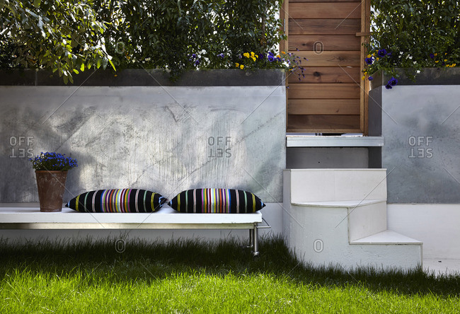 Hampstead, London, England, UK - May 7, 2013: Enclosed garden with seating