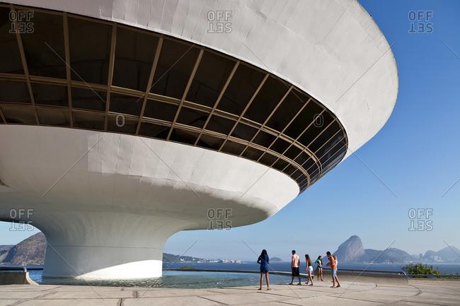 Sao Paulo, Brazil - August 1, 2013: Tourists looking in water under MAC Museu de Arte Contemporanea