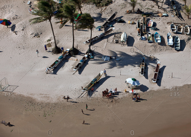 High angle view of people and boats on the beach