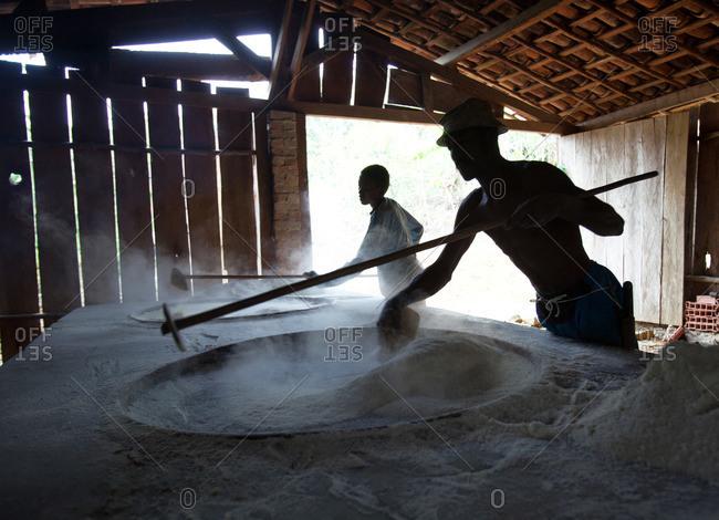 Men making flour