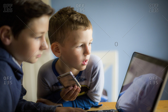 Two boys using a laptop computer