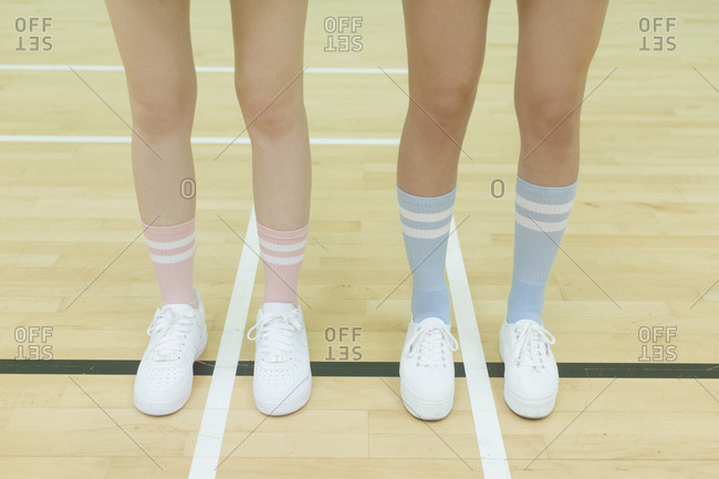 Girls' legs with sneakers and tube socks