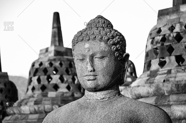Stupas and a Buddha at a temple in Java, Indonesia