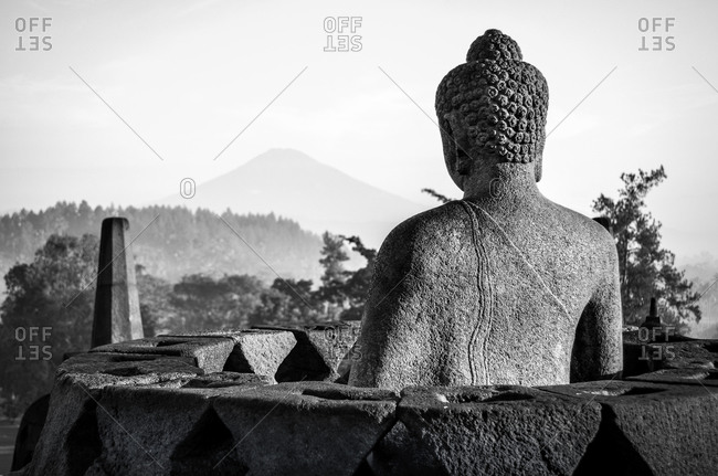 Back of a Buddha statue at a temple in Java, Indonesia