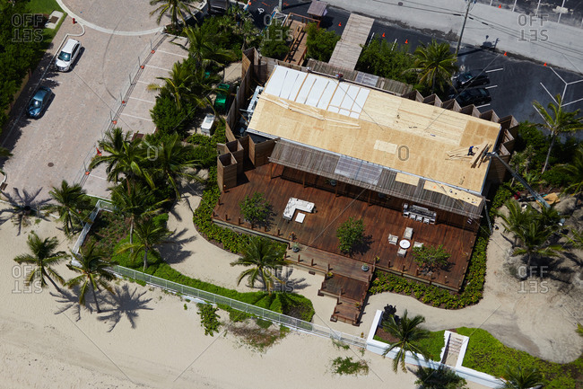 Aerial view of a beach restaurant with a wooden deck in Miami, FL