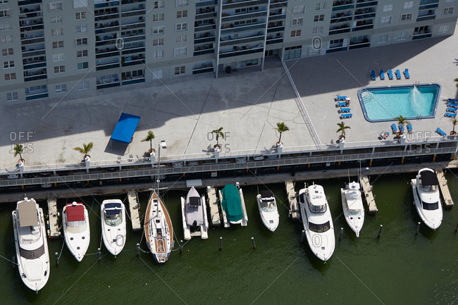 Aerial view of boats moored along the shore in Miami, FL