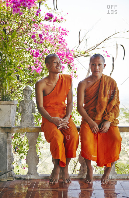 Phnom Penh, Cambodia- February 18, 2014: Two young monks at the Phnom Chisor Temple, Cambodia