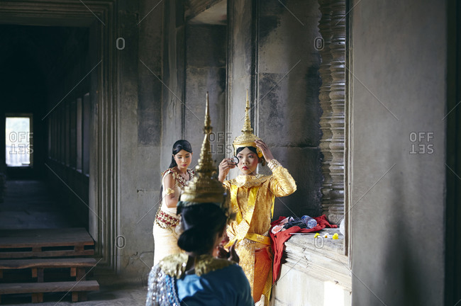 Siem Reap, Cambodia - February 21, 2014: Costumed women prepare for a performance at Angkor Wat temple, Cambodia