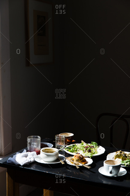 Unfinished meal on a table in a dimly lit room