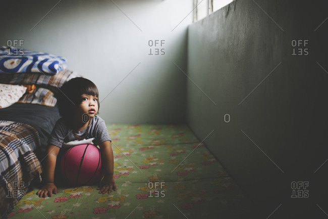 Boy with ball on the floor