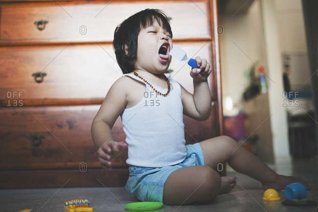 Boy playfully yelling with toy