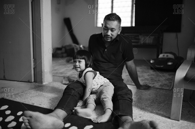 Man sitting with boy on the floor