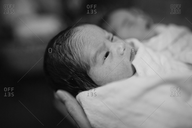 Close up of a newborn in hands